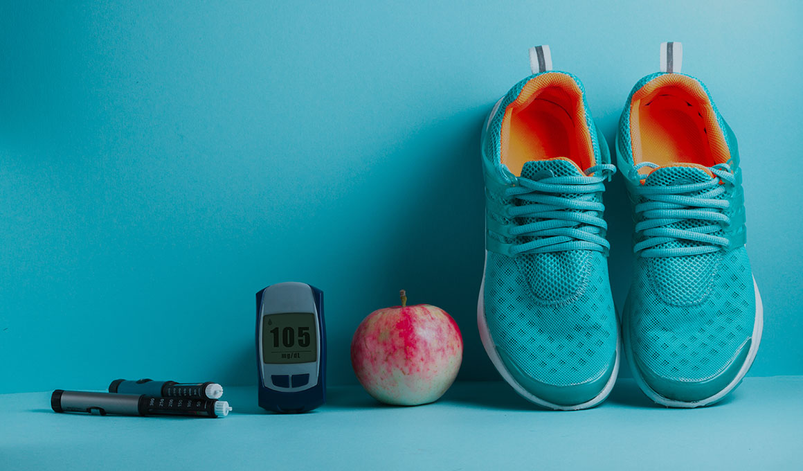 Image of tennis shoes, apple, glucose meter and insulin injector