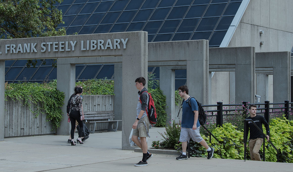 Students walking on NKU's campus outside the Steely Library.
